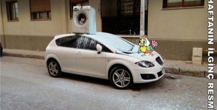 Arabanın üzerine çamaşır makinesi attı