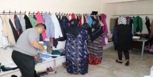 Karaköprü'de ihtiyaç sahiplerine kıyafet yardımı