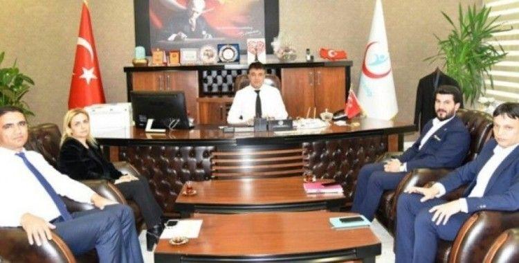 AK Parti'li Sağlam'dan Müdür Sünnetçioğlu'na ziyaret