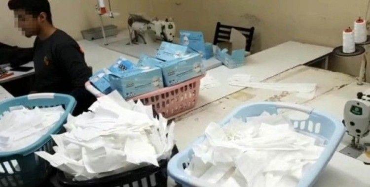 (Özel) İstanbul'da 1 milyon adet sahte maske üreten atölyeye baskın kamerada