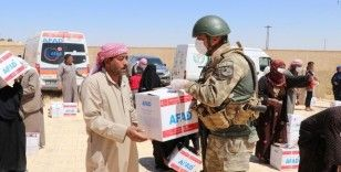 Telabyad'da altı köye insani yardımlar ulaştırıldı