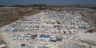 İdlib'de yapılan 'Cihannüma Evleri' ailelere teslim edildi