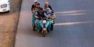 10 kişilik ailesini bir motosiklete bindirdi