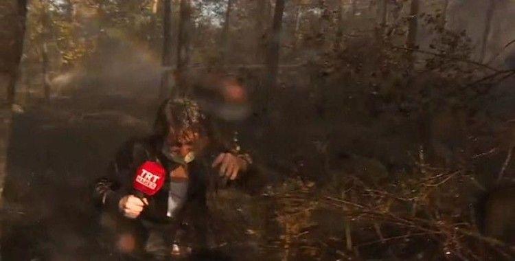 İstanbul'da yangını canlı yayında anlatan haber ekibi helikopterden boşalan suyun altında kaldı