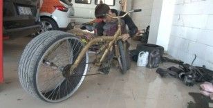 Lastiği sürekli patlayan bisikletine çözümü otomobil lastiğinde buldu
