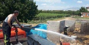 Karaman'da tutuşan kuru otlar saman balyalarını kül etti
