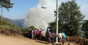 Köylüler yangın söndürme çalışmalarını üzüntüyle izledi
