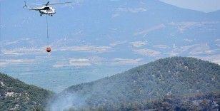 Manisa'da gece kontrol altına alınan orman yangını yeniden başladı