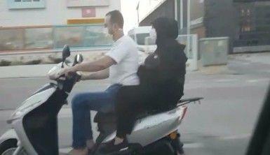 Motosiklet üzerinde bebekli çiftin tehlikeli yolculuğu