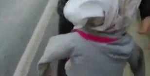 'Kardeşler aç abi' pankartıyla dilenen kadının kucağından bez bebek çıktı