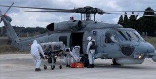 Gökçeada'da solunum güçlüğü çeken Kovid-19 hastası, helikopterle Çanakkale'ye götürüldü