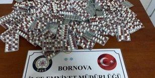 İzmir'de bekçinin dikkati binlerce uyuşturucu hapı ortaya çıkardı