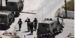İsrail güçleri ikisi çocuk 20 Filistinliyi gözaltına aldı
