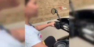 Küçük yaştaki kızına motosiklet kullandırdı, o anları kayda aldı